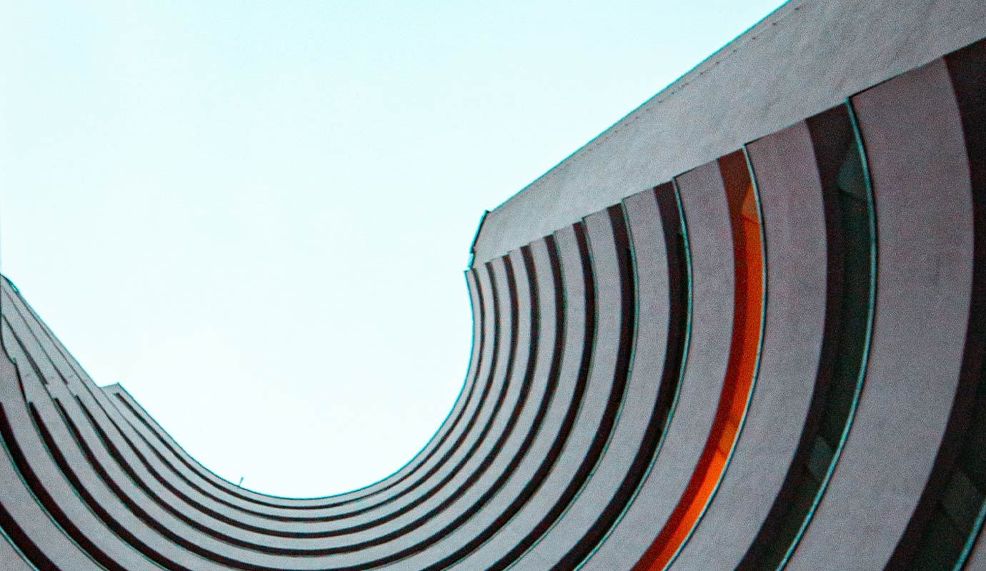 Looking up the walls of a curved building