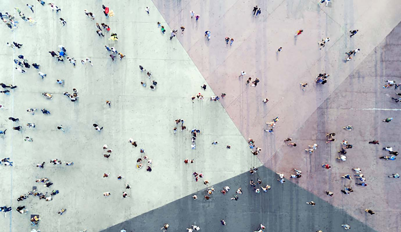 Top down view of people on mulicolored pavement