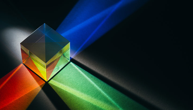 A cube prism refracts colorful light