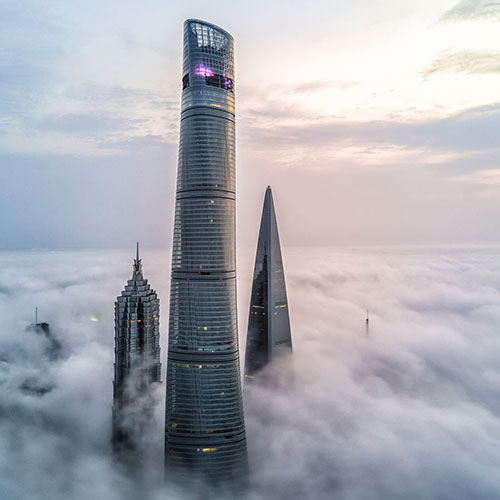 Shanghai skyscrapers through clouds