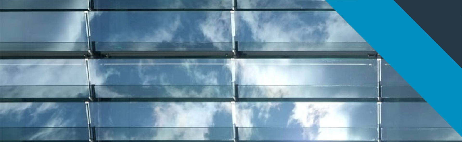 A view of a clouds in the sky through window panes