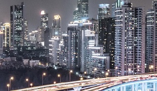 Night time view of busy city skyline