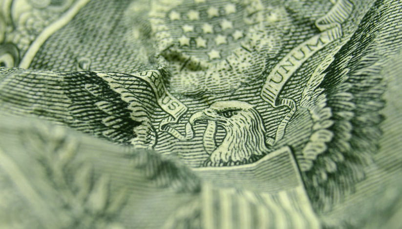 A closeup of a crinkled dollar bill.
