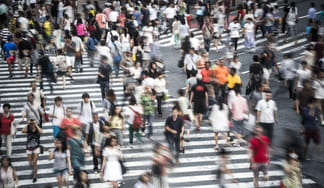 People crossing busy junction in Tokyo