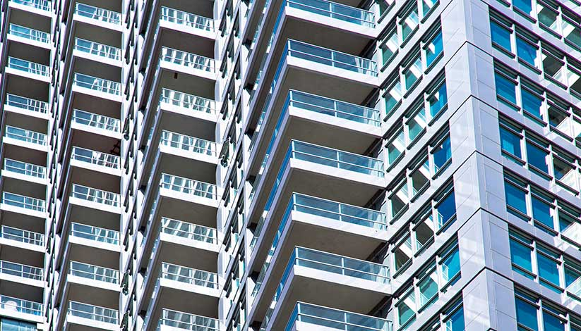 Close up image of tall apartment block