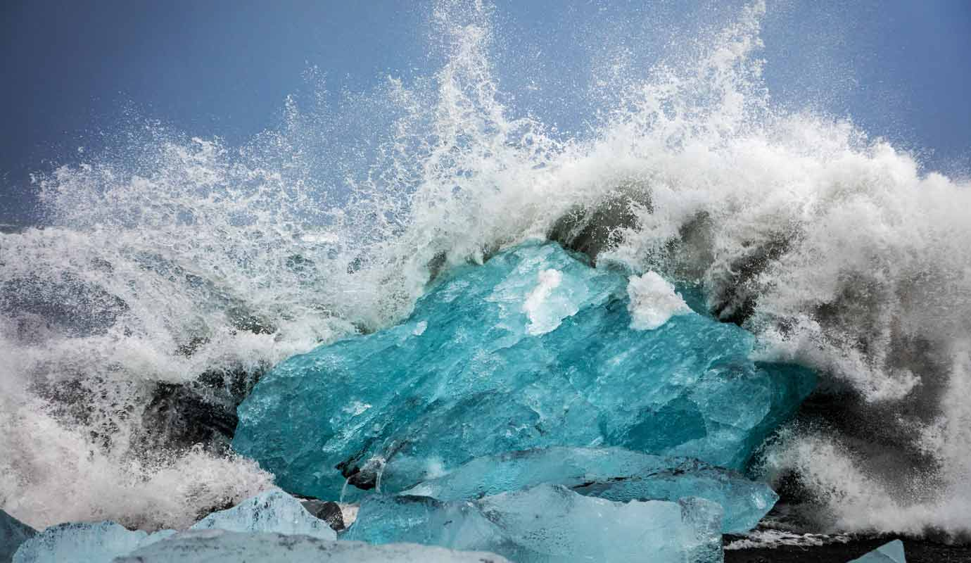 Waves crashing into ice