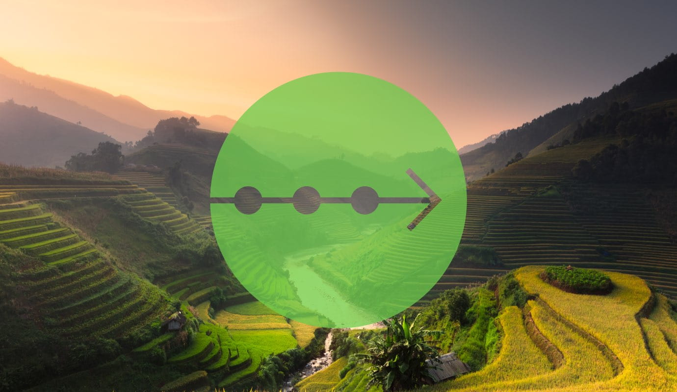 A timeline icon over a photo of farming hills