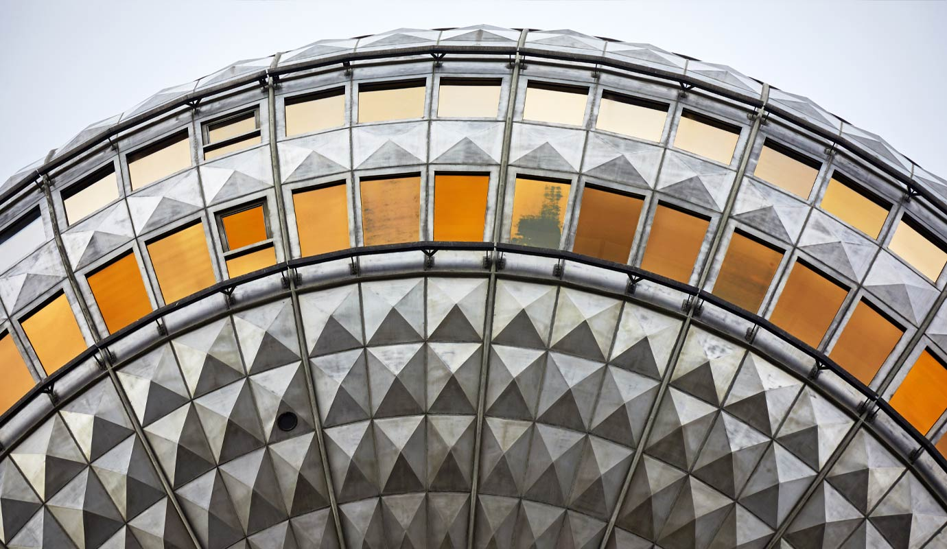 Circular orange and grey building