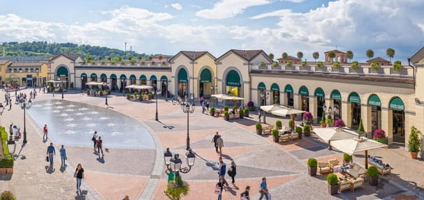 Exterior shot of public realm and fountain at Serravalle Designer Outlet