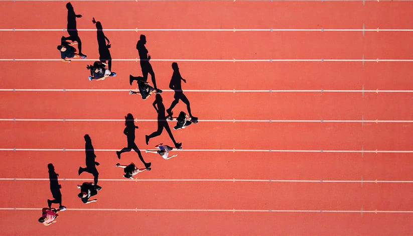 Runners on a track in a v-formation
