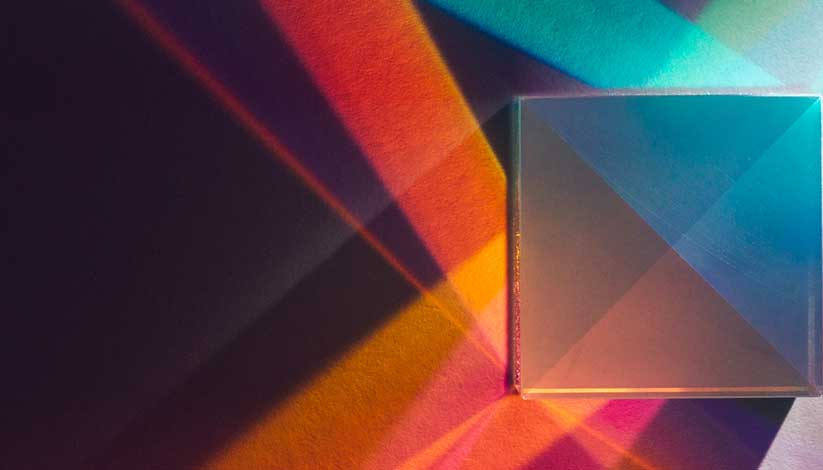A cubic prism refracts colorful light