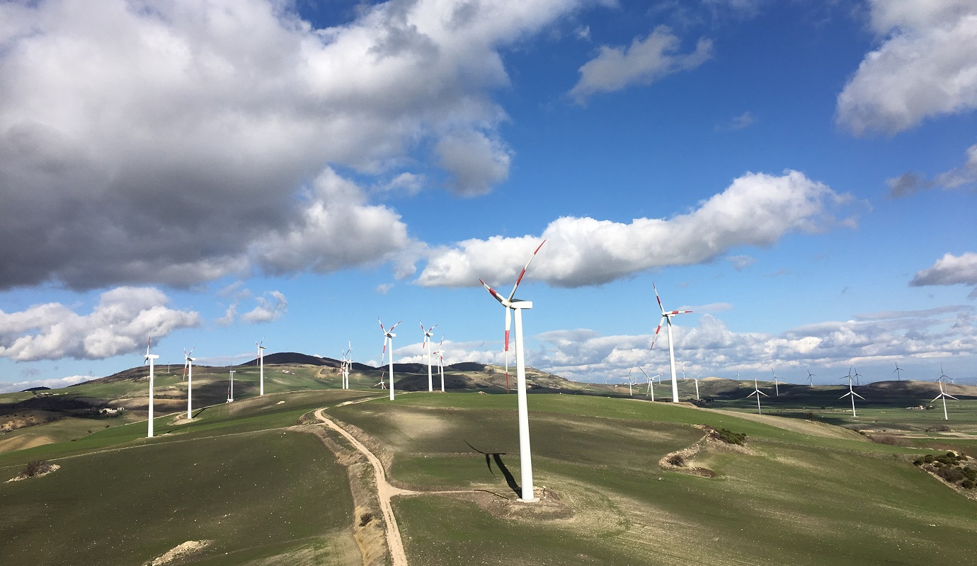 A wind farm on rolling hills
