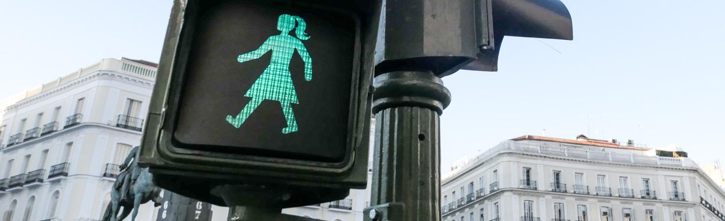 Cross-walk sign with female