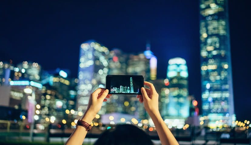 Taking photo of city with smartphone